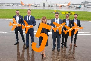 EasyJet UK manager Ali Gayward with fellow airline and airport officials to mark its fifth aircraft to be based at Glasgow. Picture: easyJet