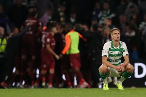 Kristoffer Ajer cuts a dejected figure as he contemplates Celtic's shock exit from the Champions League at the hands of Cluj at Celtic Park.