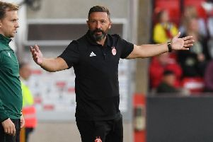 Derek McInnes questions a decision by the referee