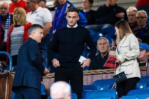 Andy King takes in the Rangers game prior to joining from Leicester on a season-long loan