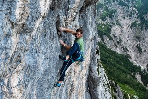 Scottish climber Robbie Phillips, 29, has become the first Briton to finish the Alpine Trilogy