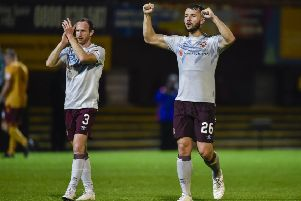 Hearts' Craig Halkett, right, and Aidy White celebrate at full-time. Picture: Rob Casey/SNS