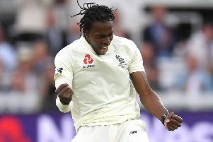 Jofra Archer celebrates after dismissing Cameron Bancroft for 13 on a rain-hit day at Lord's. Picture: Gareth Copley/Getty Images