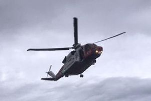 An HM Coastguard search and rescue helicopter was used to transfer the individual to hospital. Picture: John Devlin