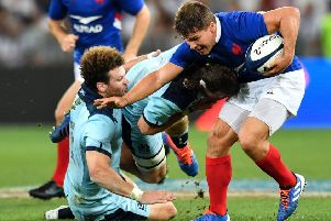 Scotland centre Duncan Taylor gets to grips with France's scrum-half Antoine Dupont. Picture: Pascal Guyot/AFP
