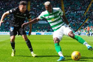 Celtic's Boli Bolingoli shields the ball from Ryan Dow of Dunfermline. Picture: SNS