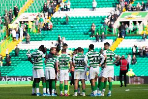 Neil Lennon talks to his Celtic players after the 2-1 extra-time win over Dunfermline Athletic.