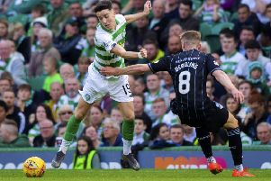 Celtic's Mikey Johnston in action against Dunfermline's Tom Beadling. Picture: Bill Murray/SNS