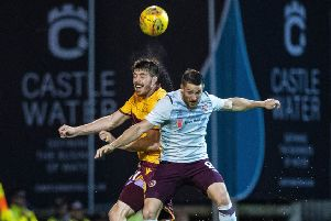 Striker Conor Washington, right, vies with Motherwell's Declan Gallagher during a morale-boosting win for Hearts. Picture: SNS.