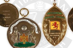 The medals which Lawrie Reilly won for Hibs' consecutive league title successes in 1951 and 1952.