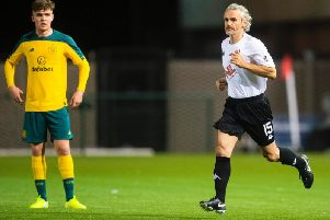 Danny Lennon takes to the pitch after subbing himself on against Celtic Colts