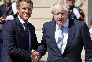 Emmanuel Macron welcomes r Boris Johnson to the Elysee Presidential Palace. Picture: Getty