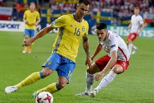 Melker Hallberg (left) and Poland's forward Mariusz Stepinski vie for the ball during the UEFA U-21 European Championships in 2017
