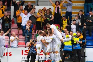 Livingston players celebrate the fourth goal.