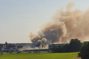 Smoke from the fire at Woodmill High School can be seen across Dunfermline. Picture: Andrew Boyle