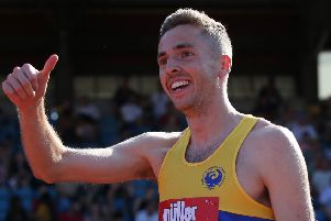 Thumbs up from Neil Gourley after winning the 1,500m UK title with an assured run in Birmingham. Picture: Steve Bardens/Getty Images