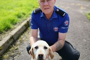 Norman Milne, a St Andrew's First Aid volunteer, with his dog Goldie