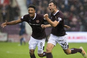 Andy Irving, right, celebrates, after equalising for Hearts against Dundee United in the Betfred Cup. Picture: SNS Group