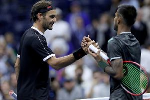 Roger Federer shakes hands with Sumit Nagal of India. Picture: Matthew Stockman/Getty Images