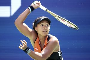 Naomi Osaka plays a return to Anna Blinkova who forced the defending champion into a deciding final set in their first-round match at Flushing Meadows. Picture: AP.