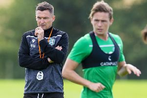Hibs manager Paul Heckingbottom observes Scott Allan during training. Picture: Ross MacDonald /SNS