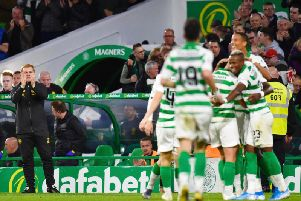 Neil Lennon applauds his players during their first-leg victory over AIK.