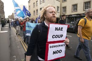Protesters from the European Movement in Scotland march on the High Street in Edinburgh