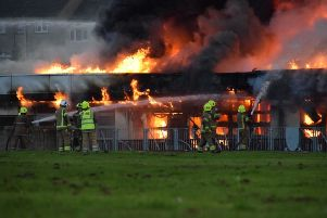 Emergency services battle the fire at  at Woodmill High School in Dunfermline. Picture: @Euans_EP/PA Wire
