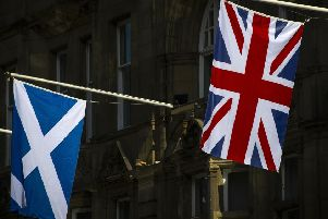 Flags have become divisive in Scotland, with the Saltire commandeered by nationalists. Picture: AFP/Getty