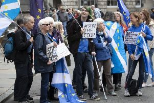 Pro-EU demonstrators outside the Court of Session in Edinburgh. Picture: PA