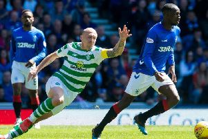 Rangers' Glen Kamara and Celtic's Scott Brown during a previous Old Firm clash.