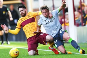 Motherwell's Liam Donnelly vies with Scott Allan of Hibs during Saturday's clash at Fir Park. Picture: SNS.