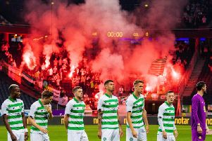 Flares are visible in the away end during Celtic's match at AIK.