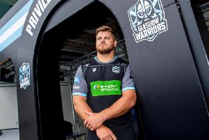 Oli Kebble helps unveil Glasgow Warriors' new home kit as he signs a contract extension at Scotstoun