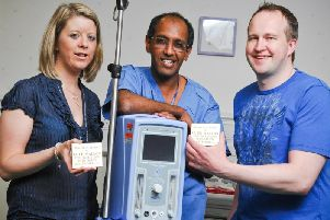 Dr Gopi Menon (centre) is remembered as kind and compassionate. Source: JPI Media.
