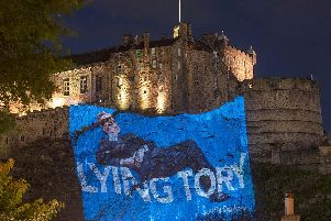Led By Donkeys projected an image of a lounging Rees-Mogg on the side of Edinburgh Castle. Pic: Tom Duffin/WeephotosofEdinburgh