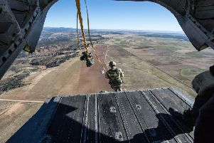 Paras leap from a Chinook helicopter during a military exercise. Picture: Ministry 'of Defence