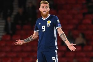 Scotland's Oli McBurnie worked hard against Russia. Picture: SNS