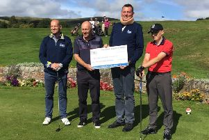 Gregor Townsend, left, and Doddie Weir, second righ't, receive a cheque at Peebles, one of many donations during their 'Borders golf tour