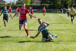 Hawick winger Logan Gordon-Wooley scores one of his two tries in his team's win away to Musselburgh on Saturday. Picture: SNS/SRU.