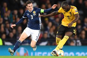 Andrew Robertson battles with Belgium striker Romelu Lukaku during Scotland's 4-0 defeat at Hampden. Picture: Andy Buchanan/AFP/Getty Images