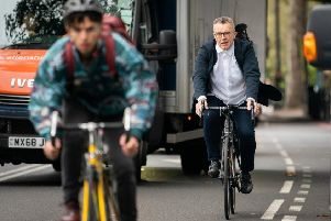 Tom Watson demonstrates his dedication to active travel as he cycles to London's Somerset House to give a speech about Brexit, but it's his dieting prowess that interests Kevan Christie (Picture: Adam Gray/SWNS)