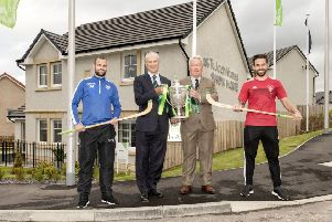 Newtonmore's Evan Menzies, left, with George Fraser, of Tulloch Homes, Camanachd Association president Keith Loades and Oban's Daniel Cameron.