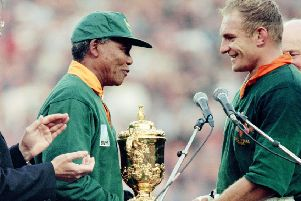June 1995, South Africa president Nelson Mandela congratulates Springbok skipper Fran�ois Pienaar after handing him the William Webb Ellis trophy. Picture: Jean-Pierre Muller/AFP/Getty Images