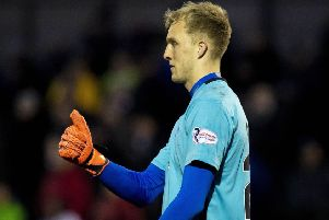 Goalkeeper Robby McCrorie was the hero for Queen of the South. Picture: Ross MacDonald/SNS Group