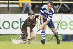 Oban's Daniel Sloss and Newtonmore's Michael Russell at the Tulloch Homes Camanachd Cup Final. Picture: Neil Paterson