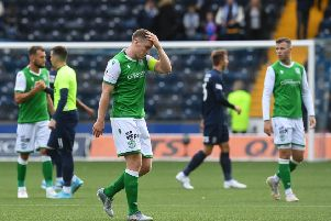 Hibs skipper Paul Hanlon feels the strain at the end of the match on Saturday. Picture: SNS.