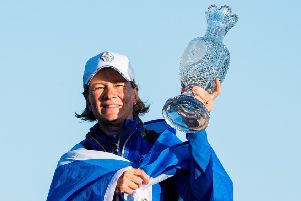 Catriona Matthew celebrates with the trophy after Europe's victory in the Solheim Cup. Picture: SNS.