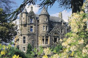 Baronial revival Knock Castle in Crieff, Perthshire has the feel of a small scale stately home