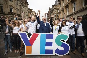 SNP Westminster leader Ian Blackford MP joins young campaigners in Glasgow city centre to mark five years since the Scottish independence referendum. Picture: PA